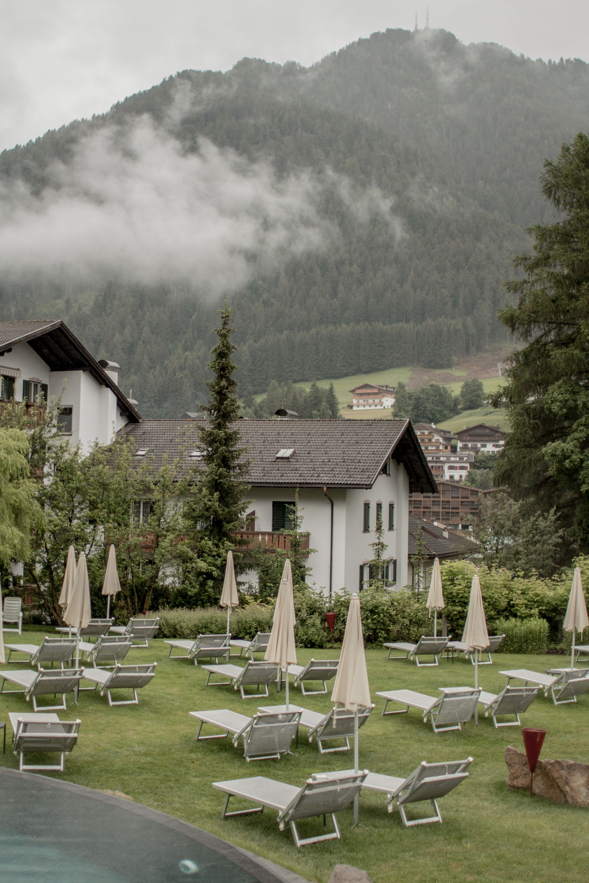 Adler Dolomites Hotel Ortisei Italy Hotel Hospitality Brand Photography Exterior pools cloud coverage