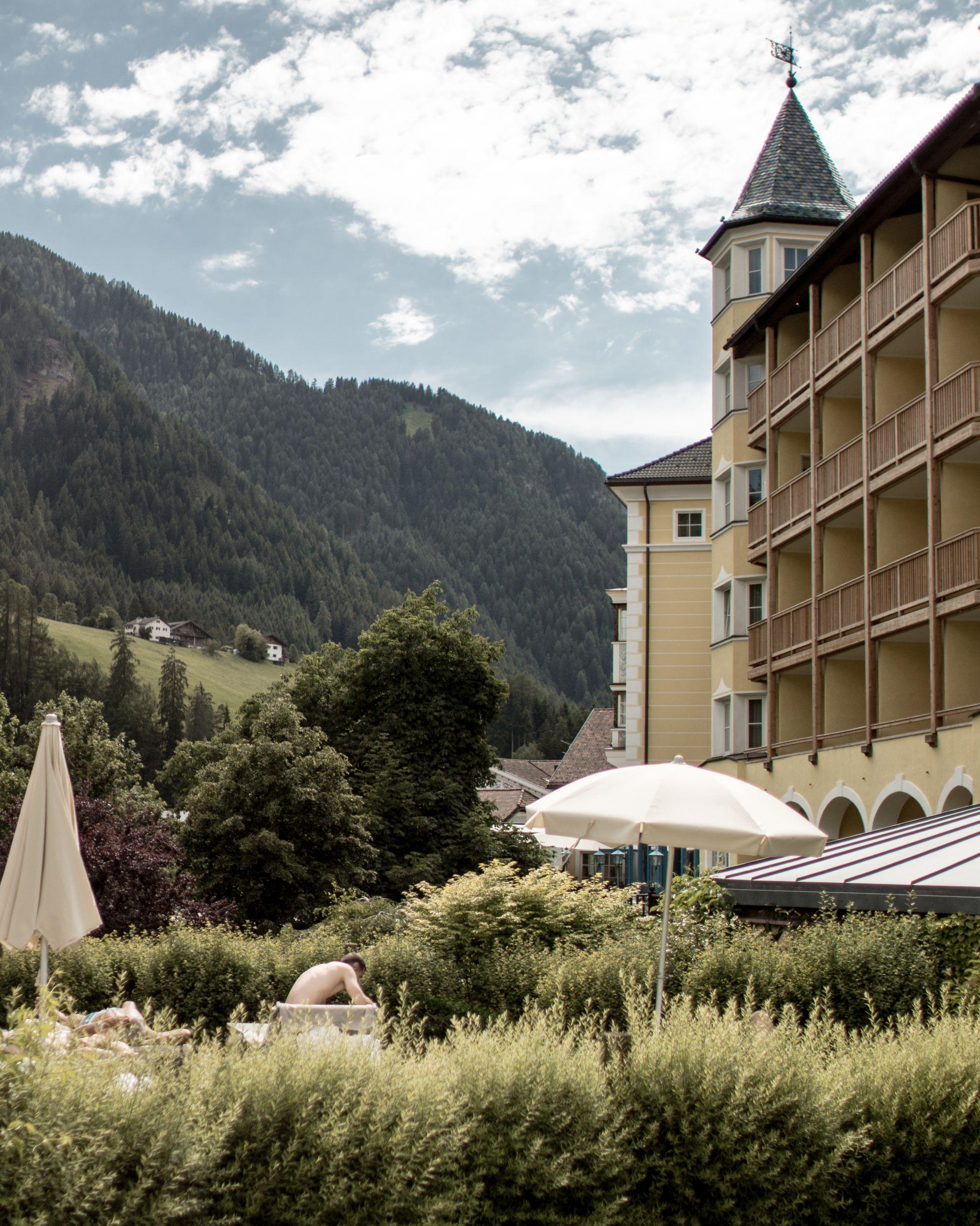 Adler Dolomites Ortisei Italy Hotel Hospitality Brand Photography Exterior Pool Sunshine