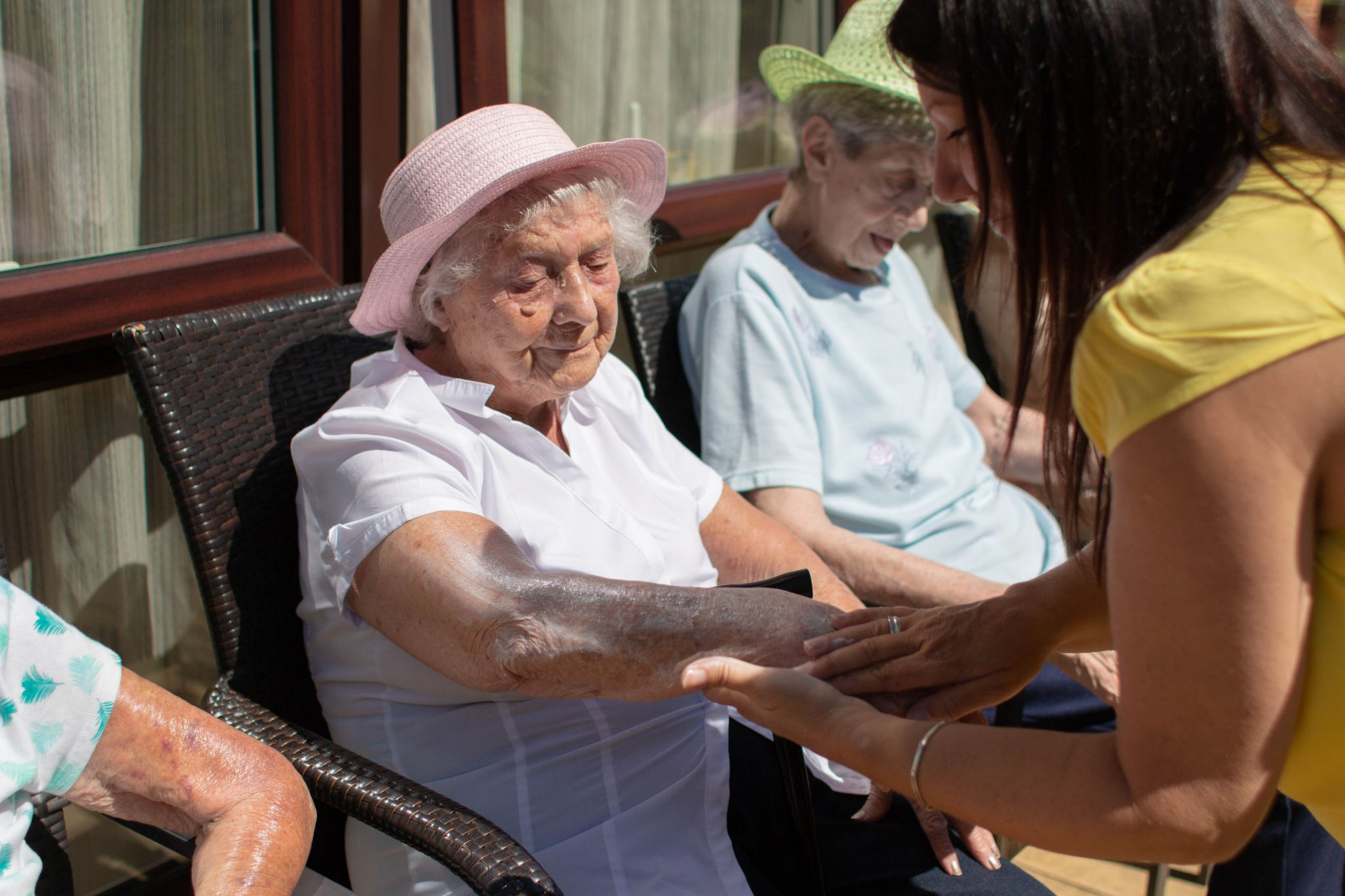 craig healthcare residents lifestyle photography hannah layford resident being helped with sun cream