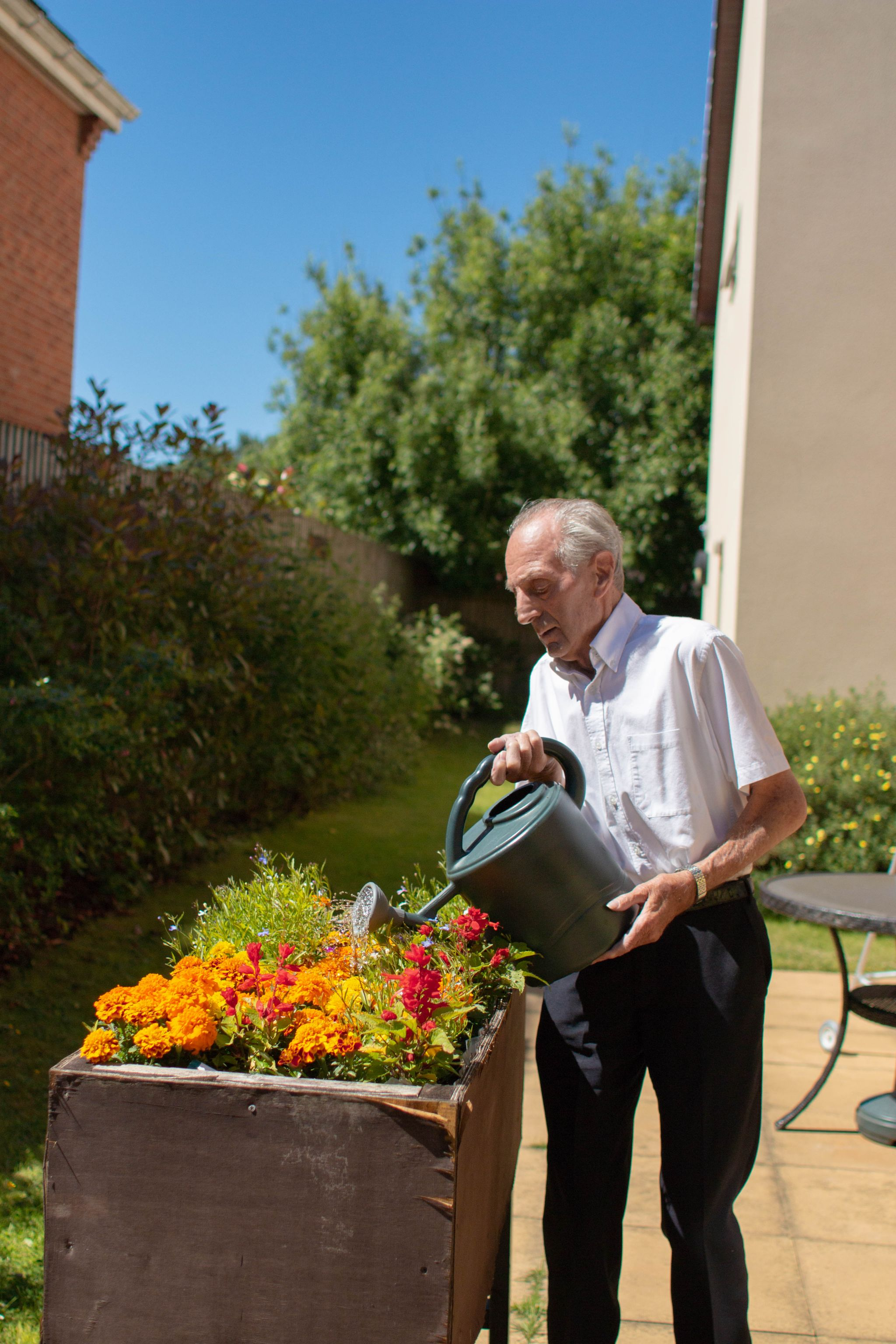 craig healthcare residents lifestyle photography hannah layford resident tending garden