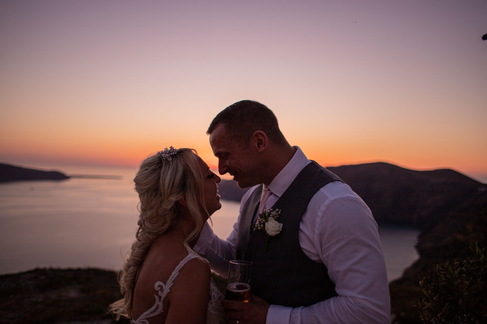 north east wedding photographer hannah layford wedding photography santorini wedding bride and groom sunset laughing