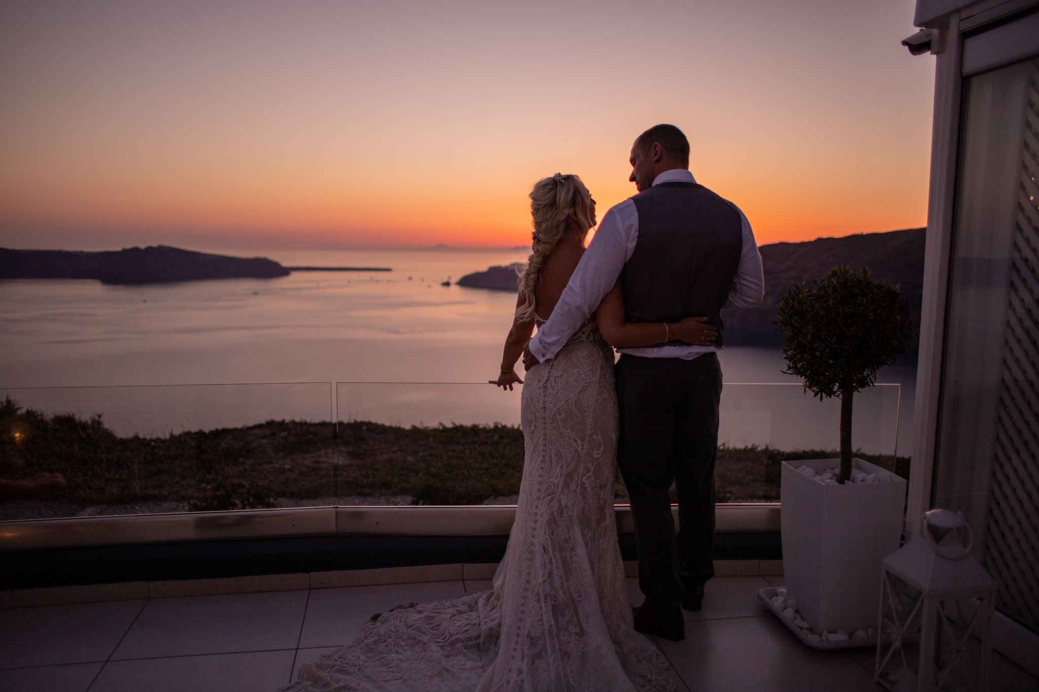 north east wedding photographer hannah layford wedding photography santorini wedding bride and groom watching sunset