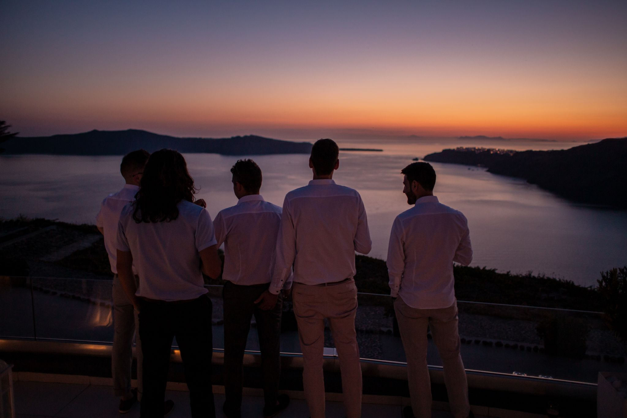 north east wedding photographer hannah layford wedding photography santorini wedding male wedding guests sunset